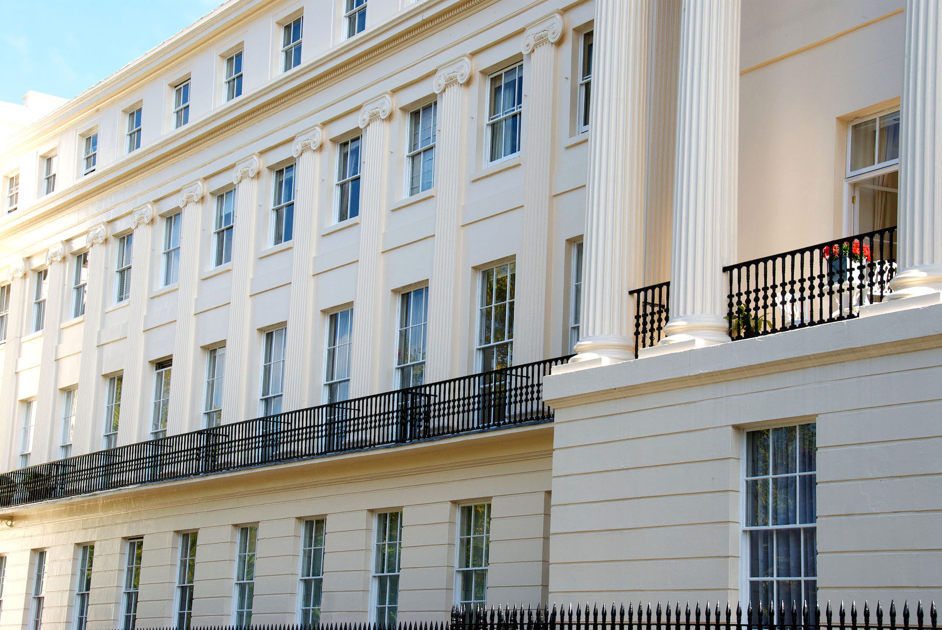 Row of Regency buildings in London, four stories, exterior decorating by Charles Adams Projects.