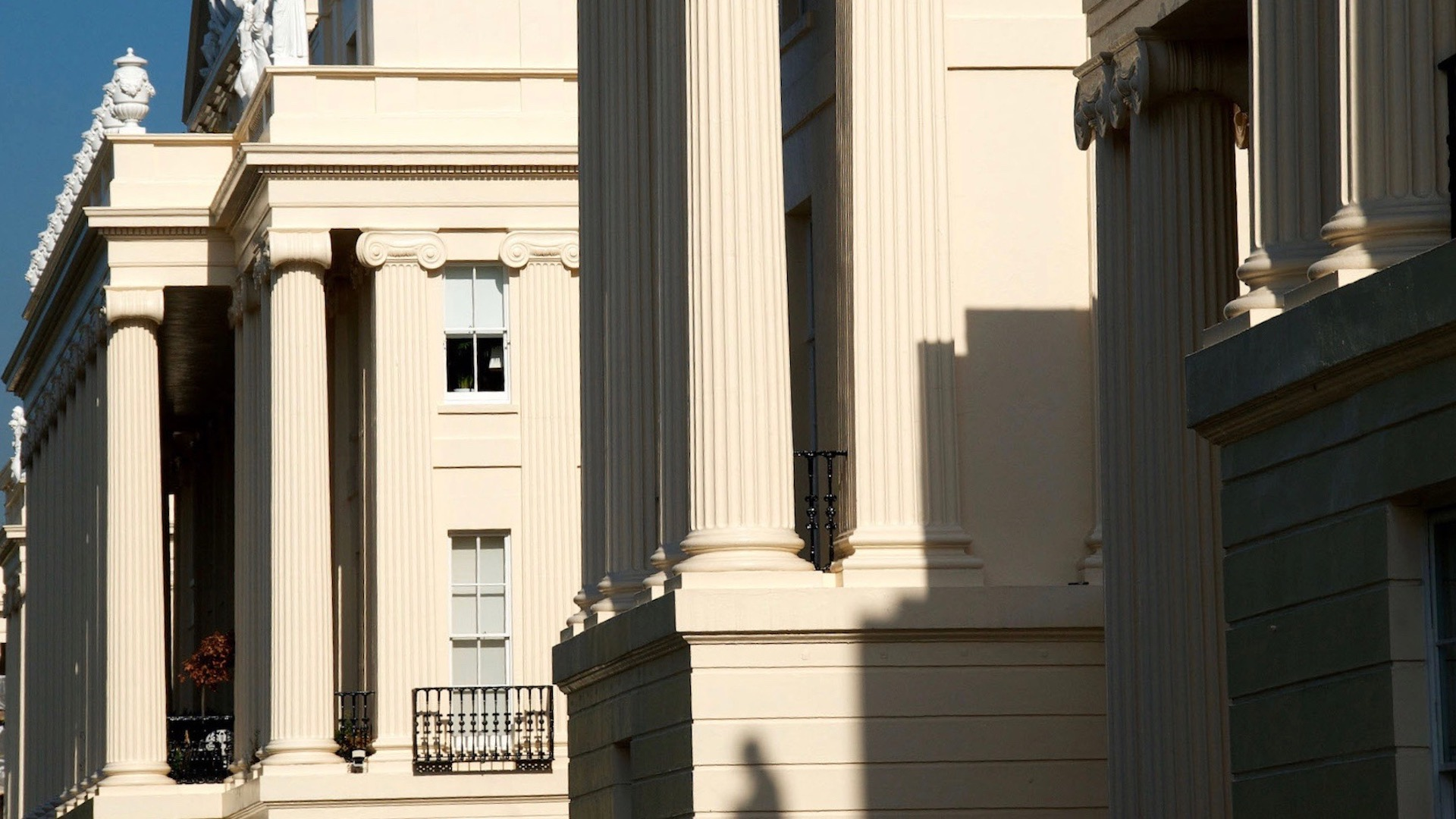 Exterior of Regency building in West London, with two-story ionic columns on the facade.