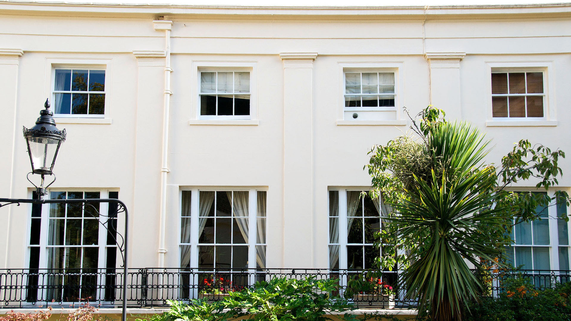 Two story Regency building in London, with exterior decorating work by Charles Adams Projects.