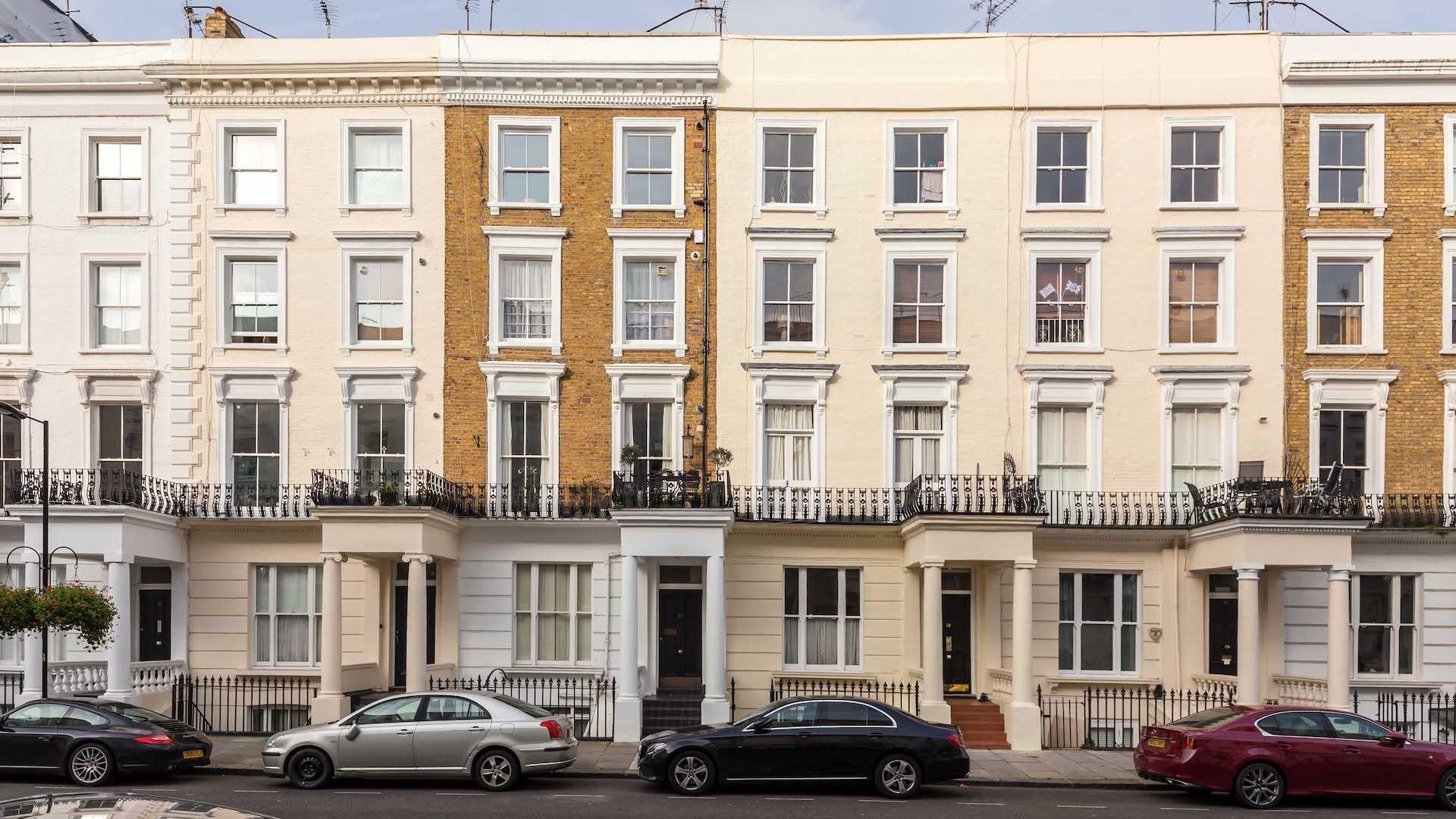 Four story terraced house with sand-coloured bricks, London.